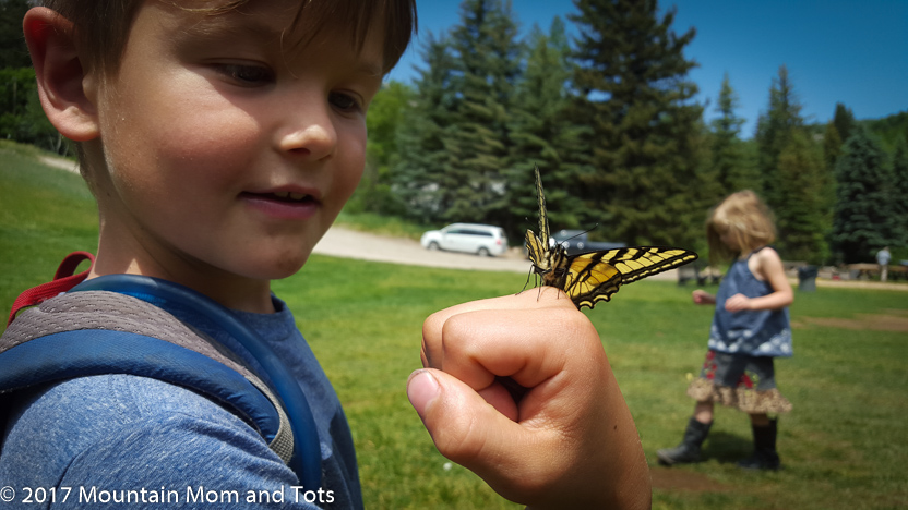 Big E holding a butterfly