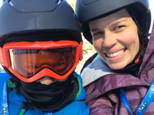 Mother and Son wearing ski helmets