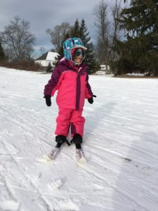 Preschool aged girl on cross country skis