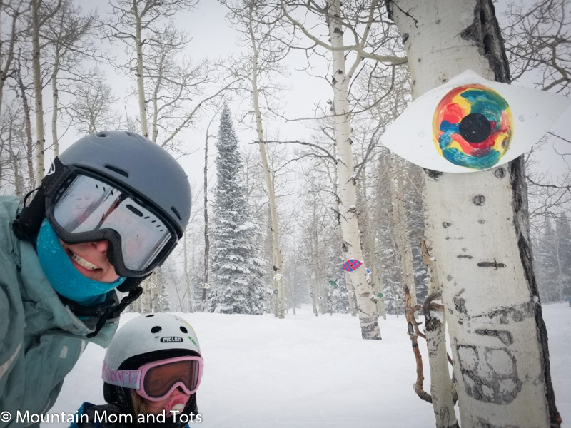 Mother and young daughter skiing